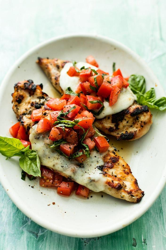 "<p>That perfect summer flavor.</p><p>Get the recipe from <a href=""https://www.delish.com/cooking/recipe-ideas/a53594/grilled-bruschetta-chicken-recipe/"" rel=""nofollow noopener"" target=""_blank"" data-ylk=""slk:Delish"" class=""link rapid-noclick-resp"">Delish</a>.</p>"