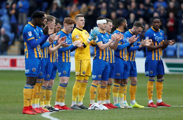 "Soccer Football - League One - Shrewsbury Town vs AFC Wimbledon - Montgomery Waters Meadow, Shrewsbury, Britain - March 24, 2018 Shrewsbury Town players observe a minute's applause before the game Action Images/Ed Sykes EDITORIAL USE ONLY. No use with unauthorized audio, video, data, fixture lists, club/league logos or ""live"" services. Online in-match use limited to 75 images, no video emulation. No use in betting, games or single club/league/player publications. Please contact your account representative for further details."