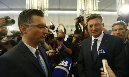 Presidential candidates Borut Pahor and Marjan Sarec answer questions from the media after the first round of the presidential election in Ljubljana