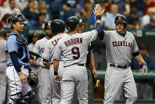 Cleveland Indians' Mark Reynolds, right, is congratulated on his three-run home run by teammate Ryan Raburn as Tampa Bay Rays catcher Jose Lobaton, left, looks on during the third inning of a baseball game on Sunday, April 7, 2013, in St. Petersburg, Fla. (AP Photo/Mike Carlson)