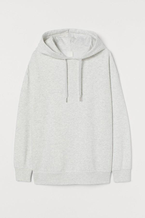 """Talking about oversized hoodies. Before you're 16 (and long after, really) you're constantly moving between classrooms, libraries, movie theaters, vintage stores, etc. What do these all have in common (hopefully)? AC. So, always stay warm and comfortable with an oversized hoodie that will feel cozy and look great with everything in your closet. $25, H&M. <a href=""""https://www2.hm.com/en_us/productpage.0763469001.html"""">Get it now!</a>"""
