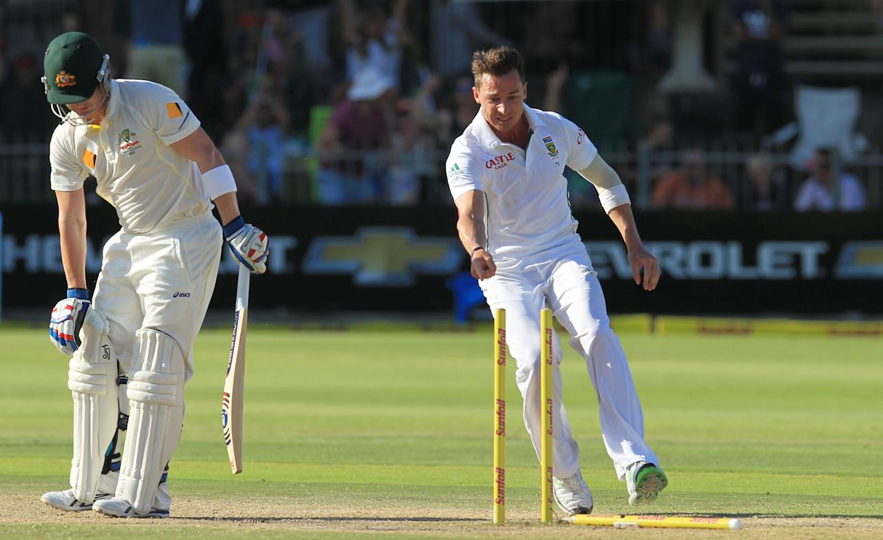 South Africa's bowler Dale Steyn, right, points at fallen stumps after after bowling Australia's batsman Brad Haddin, left, for 1 run on the fourth day of their 2nd cricket test match at St George's Park in Port Elizabeth, South Africa, Sunday, Feb. 23, 2014. (AP Photo/ Themba Hadebe)
