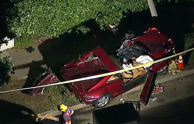"""<div class=""""caption""""> An overhead look at the Ferrari in which Bill Haas was a passenger during a car accident on Feb. 13 near Riviera Country Club. The driver of the car was killed. </div>"""