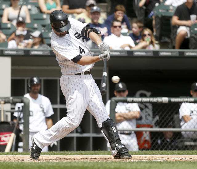 Chicago White Sox's Paul Konerko hits a home run off Minnesota Twins starting pitcher Kyle Gibson during the second inning of a baseball game Friday, Aug. 9, 2013, in Chicago. (AP Photo/Charles Rex Arbogast)