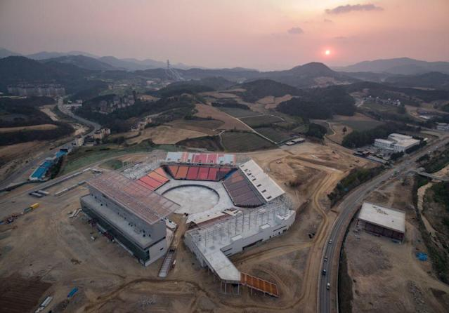 PyeongChang Stadium, seen here under construction, will be ready for Friday's chilly Opening Ceremony. (Getty)