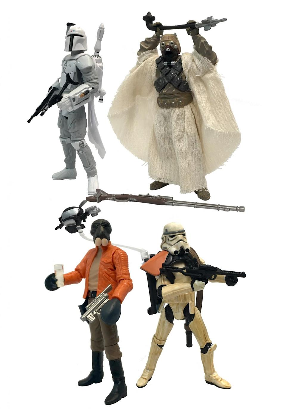 """<p>This set includes several of original mail-in exclusive figures, including a prototype white-armored Boba Fett, Ponda """"Walrus Man"""" Baba, Sandtrooper, and an alternate Tusken Raider. (Photo: Hasbro) </p>"""