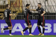 Croatia's Mateo Kovacic, right, celebrates after scoring his side's second goal during the UEFA Nations League soccer match between Croatia and Portugal at the Poljud stadium in Split, Croatia, Tuesday, Nov. 17, 2020. (AP Photo/Darko Bandic)