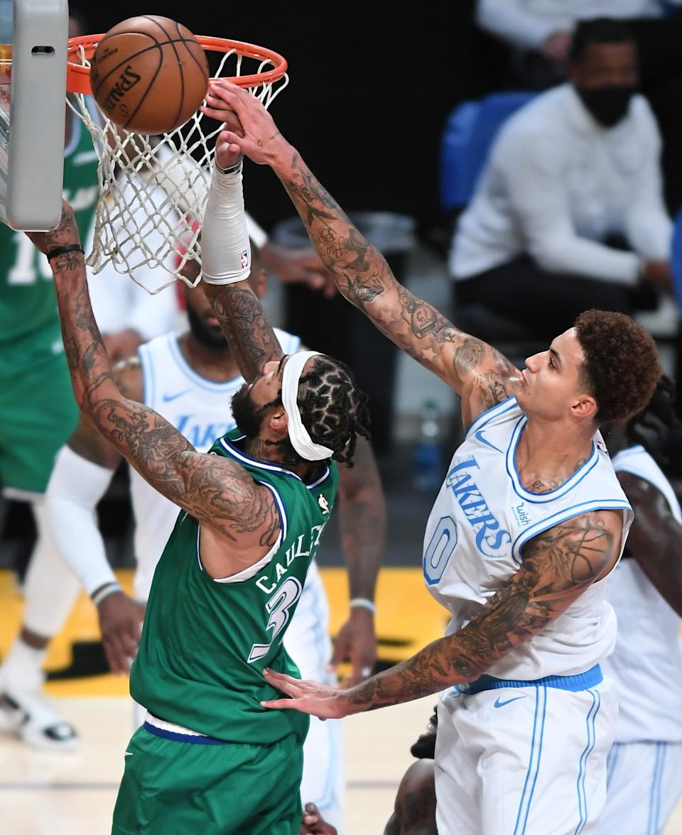 Lakers forward Kyle Kuzma blocks a shot by Mavericks center Willie Cauley-Stein in the third quarter.