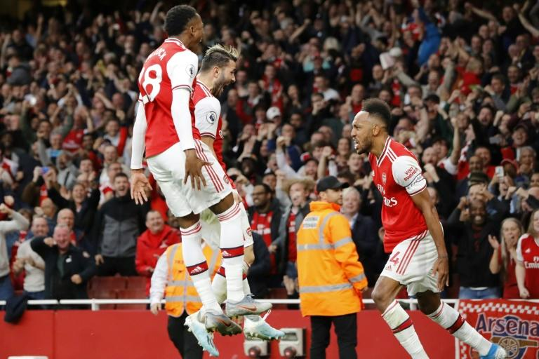 Top Gunner: Pierre-Emerick Aubameyang (right) celebrates scoring the winner in a thrilling 3-2 victory over Aston Villa