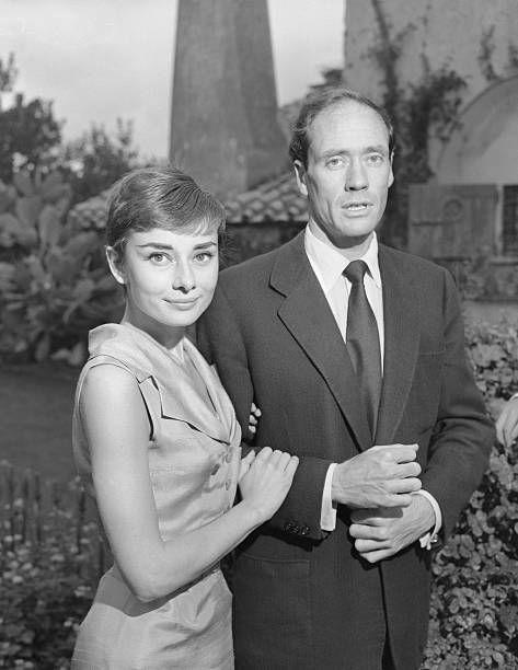 "<p>Hepburn met actor husband Mel Ferrer, when the two co-starred in the Broadway show, <em>Ondine</em>, for which she won her Tony. The <a href=""https://www.biography.com/actor/audrey-hepburn"" rel=""nofollow noopener"" target=""_blank"" data-ylk=""slk:couple secretly married in Switzerland"" class=""link rapid-noclick-resp"">couple secretly married in Switzerland</a> in 1954 after leading the paparazzi on a wild chase to elude them (it was her first, his fifth marriage). The two divorced in 1968.</p>"