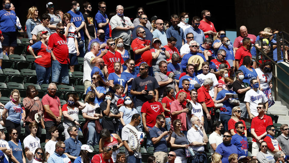 ARLINGTON, TEXAS - APRIL 05: Fans stand for the National Anthem before the Texas Rangers take on the Toronto Blue Jays on Opening Day at Globe Life Field on April 05, 2021 in Arlington, Texas. (Photo by Tom Pennington/Getty Images)