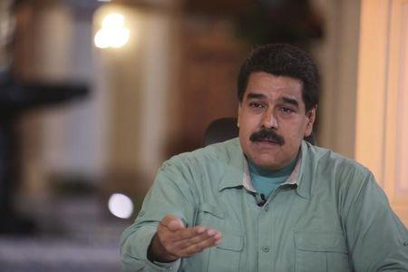 """Venezuela's President Nicolas Maduro gestures as he speaks during his weekly broadcast """"In contact with Maduro"""" in Caracas in this handout picture provided by Miraflores Palace"""