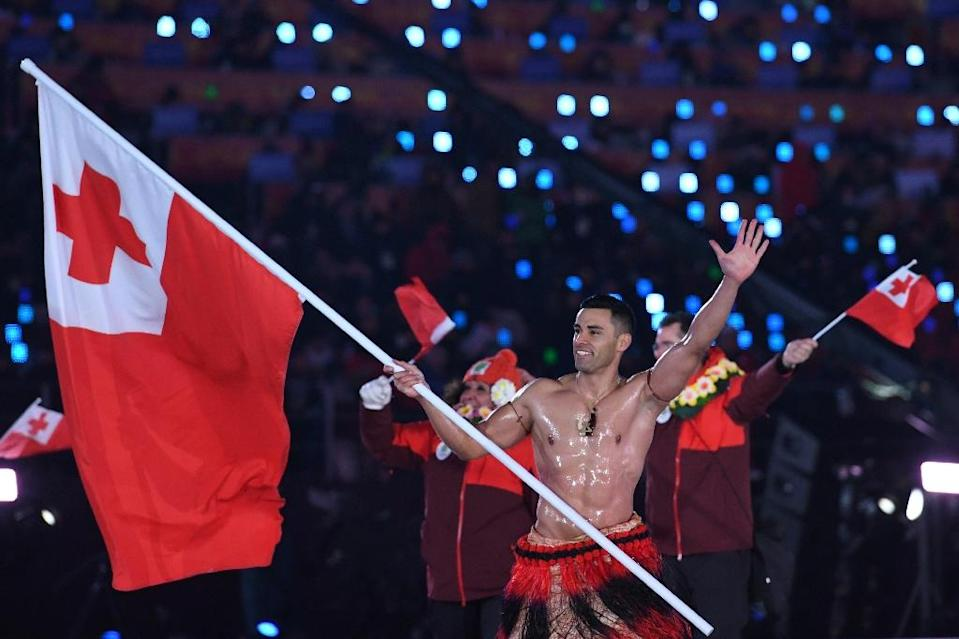 Tonga's flag-bearer Pita Taufatofua stunned viewers by appearing topless at the ceremony. (AFP)