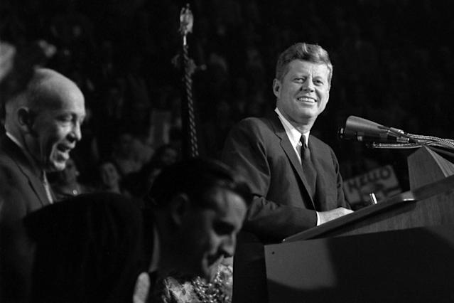 <p>John F. Kennedy addresses the Bean Feed at the Hippodrome in St. Paul, Minn., Oct. 6, 1962. In the foreground are State Democratic Chairman George Farr and Minnesota Attorney General Walter F. Mondale. (Photo: Cecil Stoughton/John F. Kennedy Presidential Library and Museum) </p>