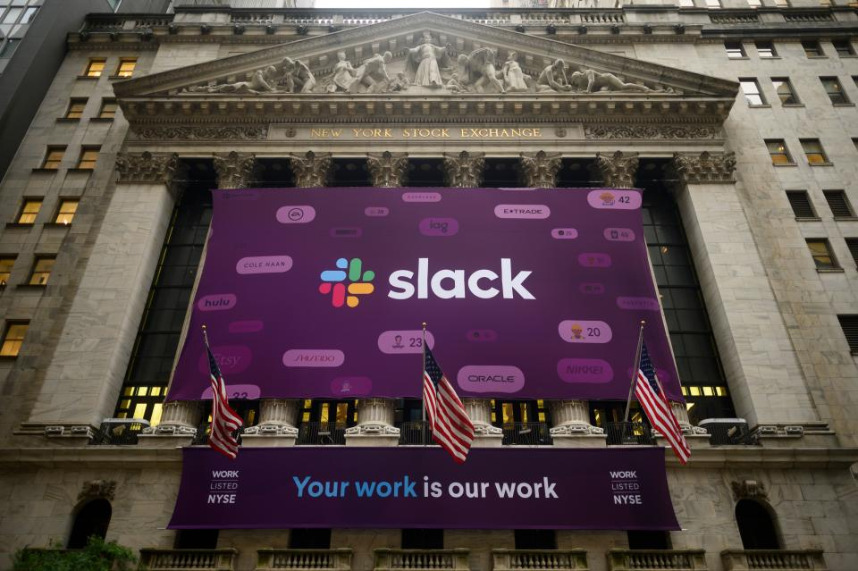The logo of the Slack Technologies Inc. is seen outside the New York Stock Exchange (NYSE) after their company  public offering (IPO) on June 20, 2019 located at Wall Street in New York City. - Software company Slack Technologies climbed on the New York Stock Exchange Thursday after debuting in a direct listing, in the latest sign of Wall Street's appetite for new technology entrants.Shares of the company, whose arrival was marked with a giant purple banner outside the NYSE, initially surged as high as $42 before pulling back somewhat and finishing at $38.62. The exchange had set a reference price of $26. (Photo by Johannes EISELE / AFP)        (Photo credit should read JOHANNES EISELE/AFP/Getty Images)