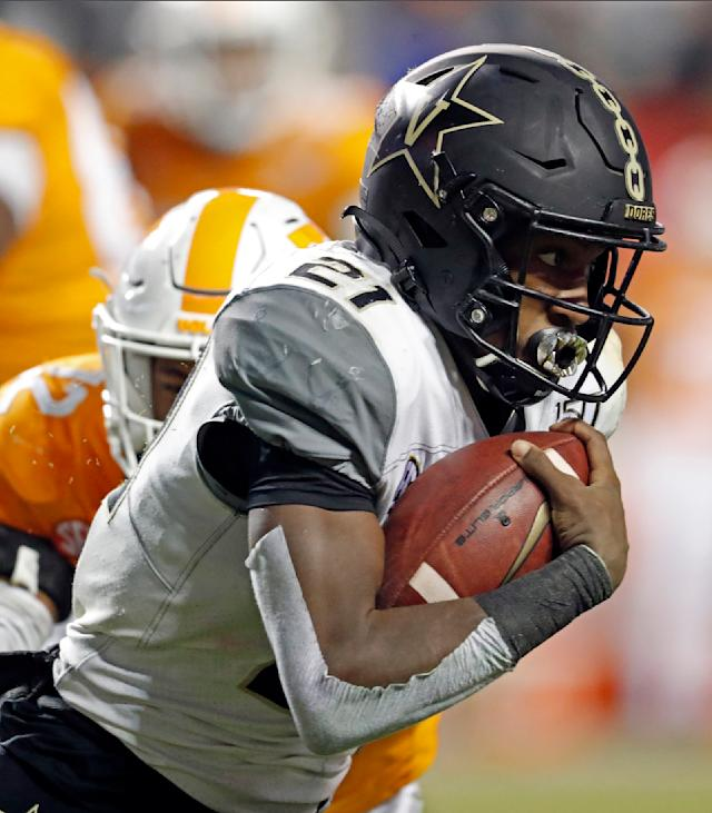 Vanderbilt running back Keyon Brooks (21) runs for yardage in the second half of an NCAA college football game against Tennessee, Saturday, Nov. 30, 2019, in Knoxville, Tenn. (AP Photo/Wade Payne)