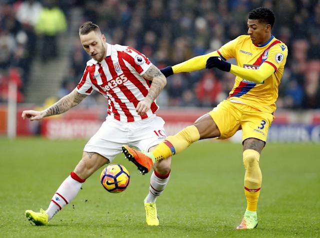 <p>Stoke City's Marko Arnautovic and Crystal Palace's Patrick Van Aanholt battle for possession</p>