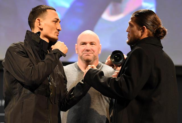 Max Holloway (left) and Brian Ortega face off during the UFC 231 press conference at the Winter Garden Theatre on Dec. 5, 2018, in Toronto. (Getty Images)