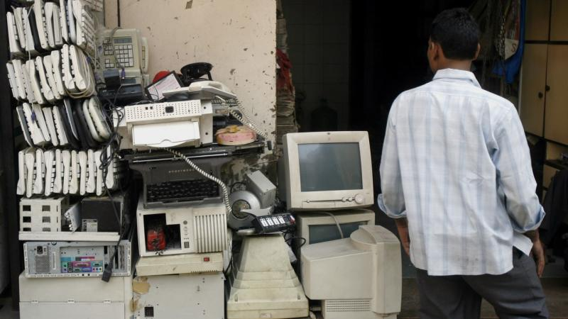 A man walks past electronic waste at a junk shop in Mumbai. Reuters