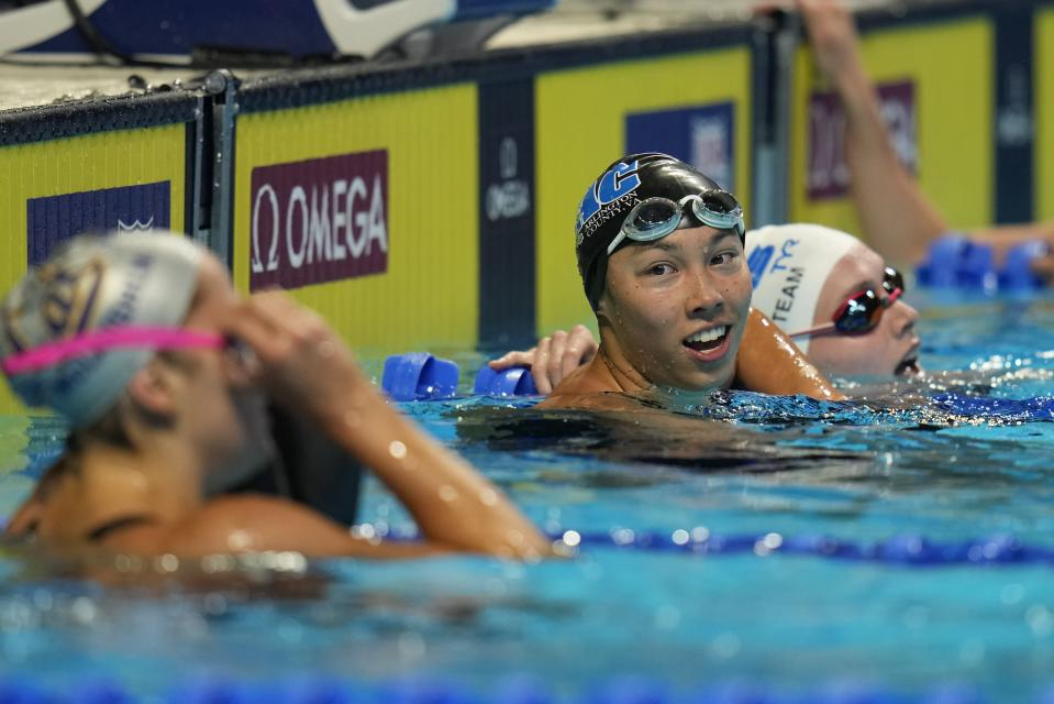 Torri Huske smiles after winning her heat in the Women's 100 Butterfly during wave 2 of the U.S. Olympic Swim Trials on Sunday, June 13, 2021, in Omaha, Neb. (AP Photo/Jeff Roberson)