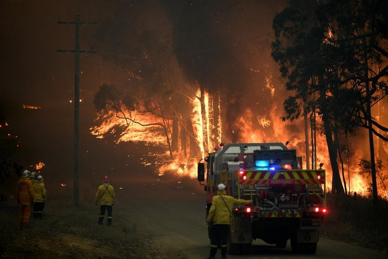 NSW Rural Fire Service crews fight a fire as it burns close to property on Wheelbarrow Ridge Road at Colo Heights, north west of Sydney