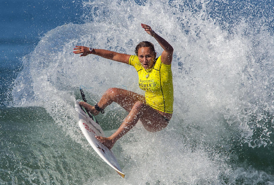FILE - In this Sept. 9, 2014, file photo, Carissa Moore surfs during round one of the Swatch Women's Pro Trestles competition in San Clemente, Calif. Professional surfers will be riding the waves again Sunday, Aug. 9, for the first time since the coronavirus pandemic shut down the sport in March. The Surf Ranch in Lemoore, Calif., some 100 miles from the Pacific Ocean, will provide a perfect bubble for the World Surf League's Rumble at the Ranch featuring 16 surfers, including 11-time world champion Kelly Slater and Olympic qualifiers Kolohe Andino, Caroline Marks and four-time reigning world champ Moore. (Mark Rightmire/The Orange County Register via AP, File)