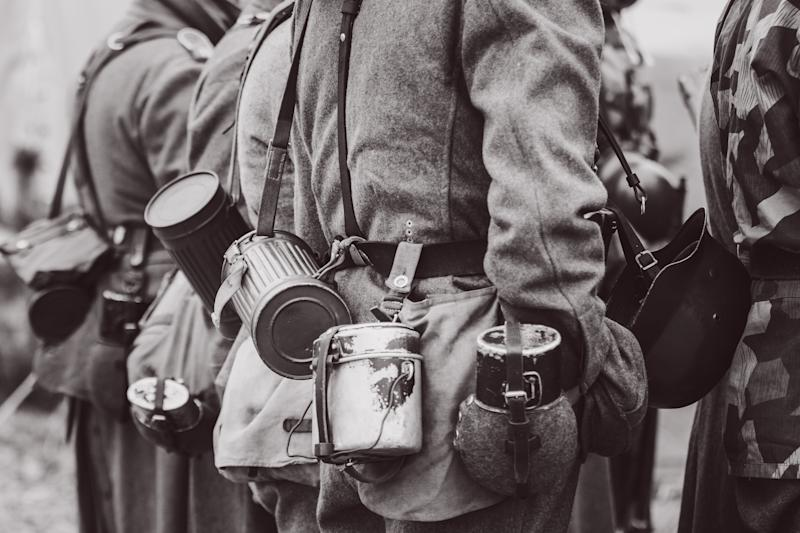 Container for gas mask bowler and flask for drinking on the Wehrmacht soldier in a uniform since the Second World War. Black and white photography