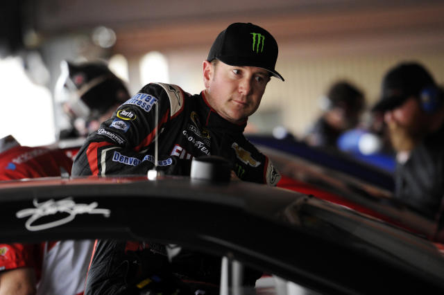 Kurt Busch climbs into his car during practice for Sunday's NASCAR Sprint Cup series auto race, Friday, Sept. 27, 2013, at Dover International Speedway in Dover, Del. (AP Photo/Nick Wass)
