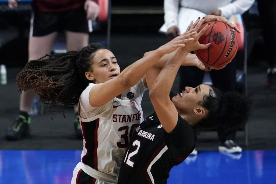 Stanford guard Haley Jones (30) blocks a shot by South Carolina guard Brea Beal (12) during the second half of a women's Final Four NCAA college basketball tournament semifinal game Friday, April 2, 2021, at the Alamodome in San Antonio. (AP Photo/Eric Gay)