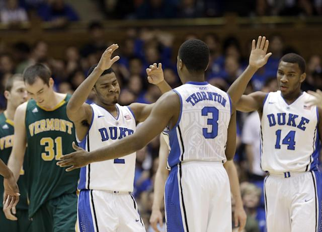 Duke's Quinn Cook, Tyler Thornton (3) and Rasheed Sulaimon (14) react following a play as Vermont's Clancy Rugg (31) walks away during the second half of an NCAA college basketball game in Durham, N.C., Sunday, Nov. 24, 2013. Duke won 91-90. (AP Photo/Gerry Broome)