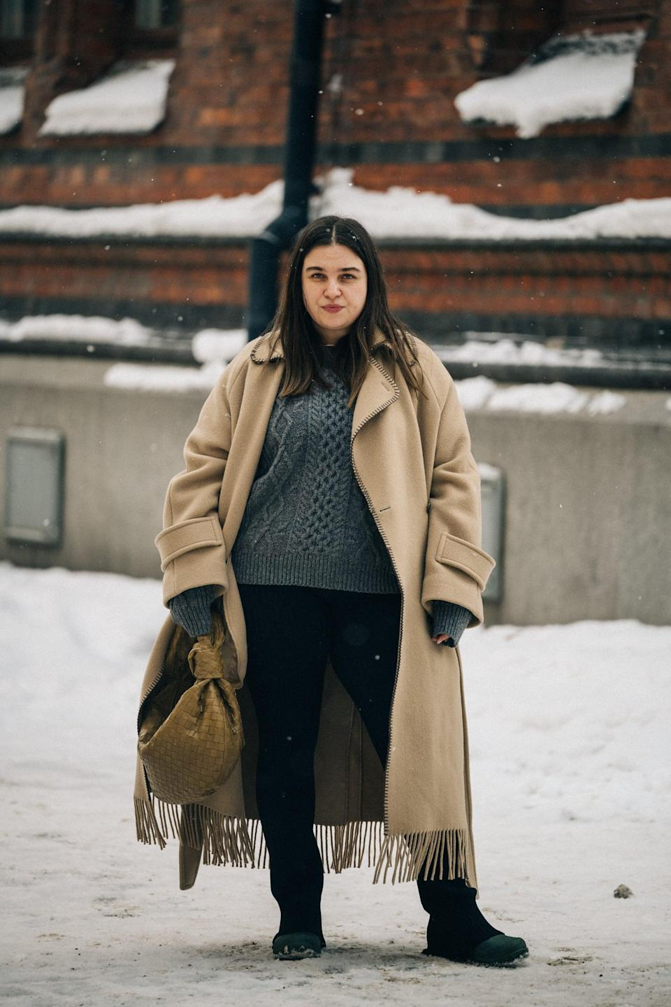 <p>Wear a cable-knit sweater with a long felt coat to amp up the wintry vibes.</p>