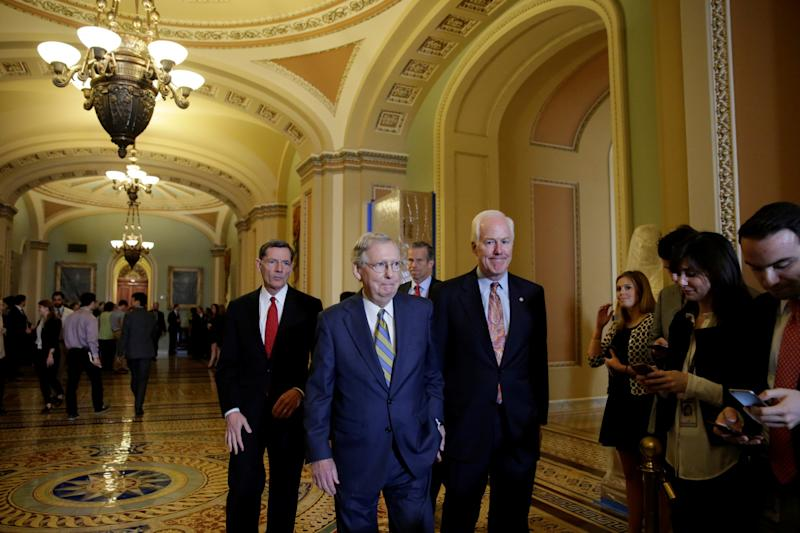 Senate Majority Leader Mitch McConnell, center, arrives to talk to the media in Washington on May 23. (Photo: Yuri Gripas/Reuters)