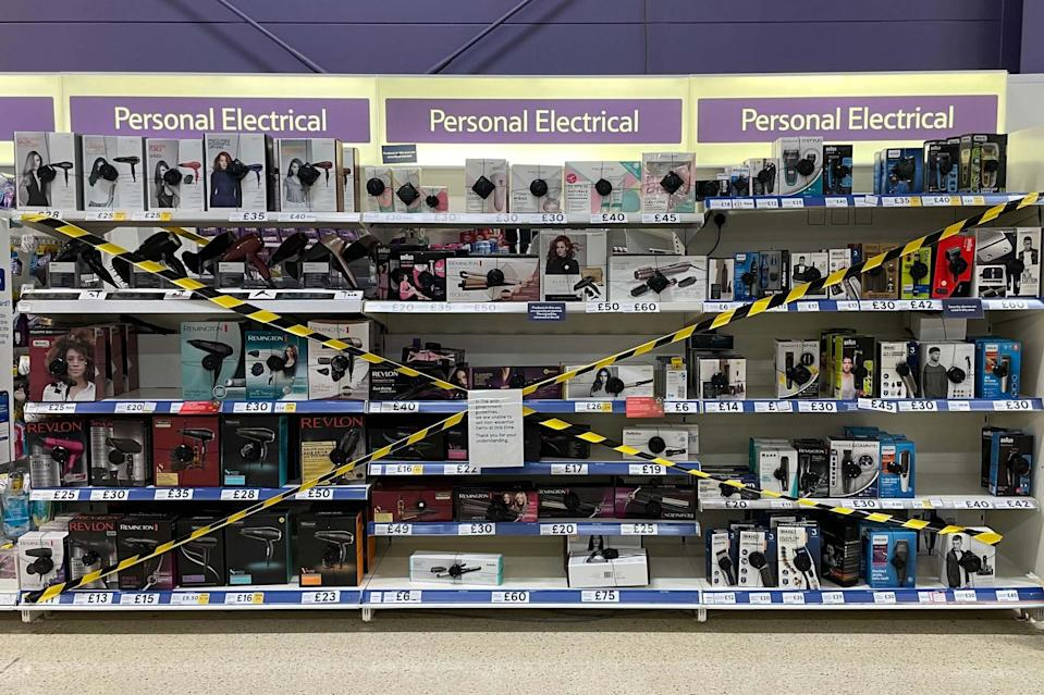 Non-essential items are sealed off in a Tesco store in Pengam Green in Cardiff, Wales: Getty Images