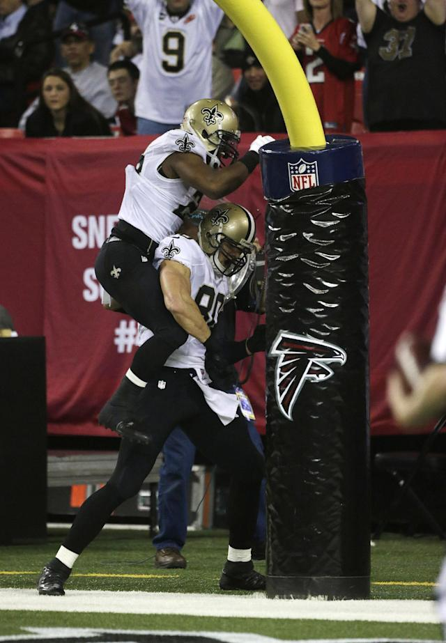 New Orleans Saints tight end Jimmy Graham (80)celebrates his touchdown against the Atlanta Falcons during the first half of an NFL football game, Thursday, Nov. 21, 2013, in Atlanta. (AP Photo/Dave Martin)