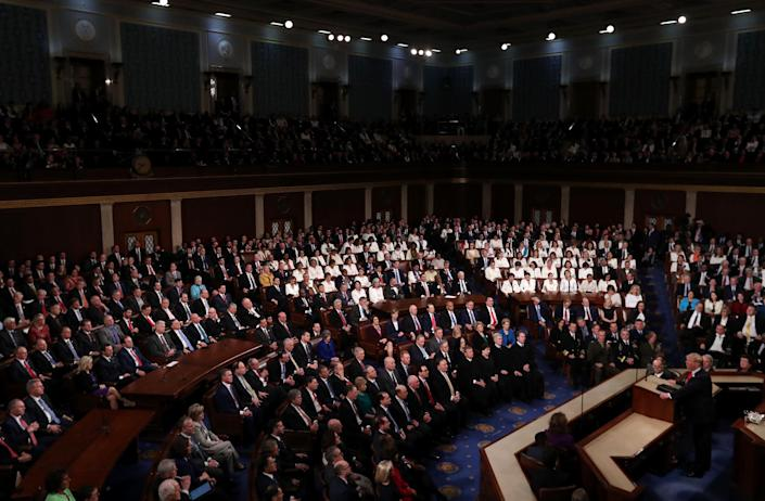 A sweeping view shows dozens of Democratic congresswomen wearing white during President Trump's State of the Union address in Washington, D.C., on Feb. 5, 2019.