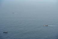 Fishing boats are seen from an aircraft of the Ecuadorian navy after a fishing fleet of mostly Chinese-flagged ships was detected in an international corridor that borders the Galapagos Islands' exclusive economic zone, in the Pacific Ocean