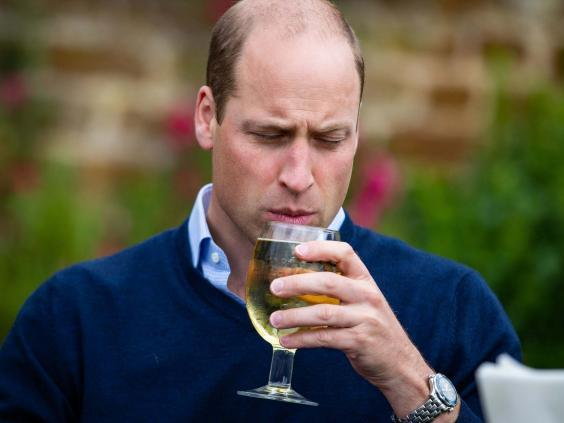 The Duke of Cambridge takes a sip of an Aspalls cider at The Rose and Crown pub in Snettisham, Norfolk. (PA)