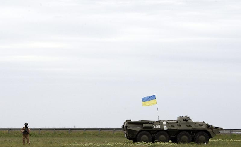 Ukrainian troops secure an area outside the southern city of Odessa on May 9, 2014