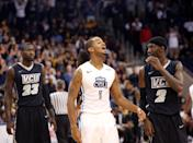 Old Dominion's Aaron Bacote, center, calls out to the crowd in the final seconds of an NCAA college basketball game, as Virginia Commonwealth's Jarred Guest, left, and Briante Weber watch, Saturday, Nov. 29, 2014, in Norfolk, Va. Old Dominion won 73-67. (AP Photo/The Virginian-Pilot, Steve Earley)
