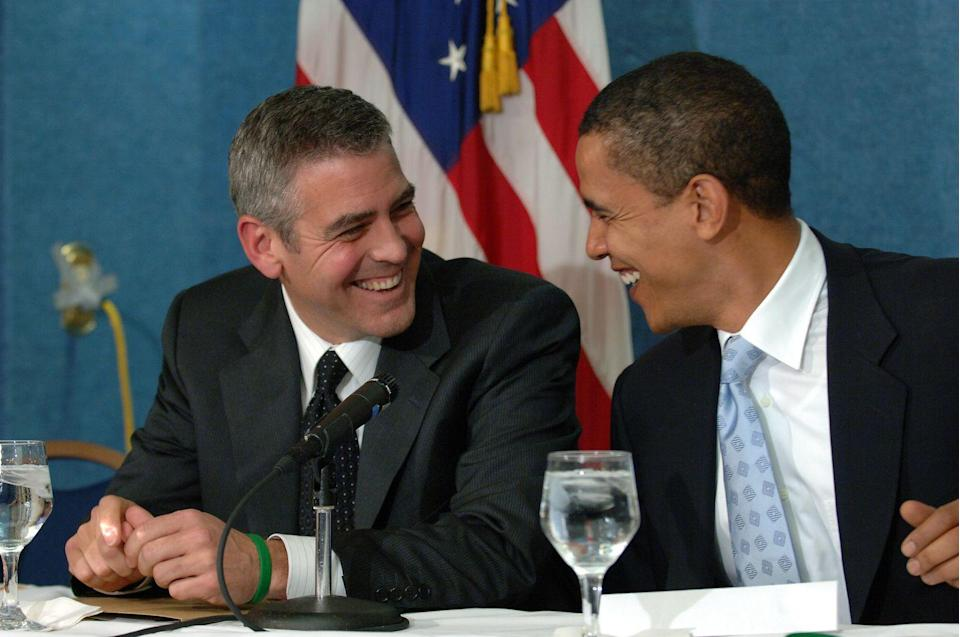 <p>Clooney and Barack Obama talk during a press conference in Washington, DC on April 27, 2006. Clooney spoke about his recent visit to the Darfur region of Sudan.</p>