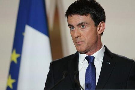 Former French prime minister Manuel Valls reacts after partial results in the second round of the French left's presidential primary election in Paris