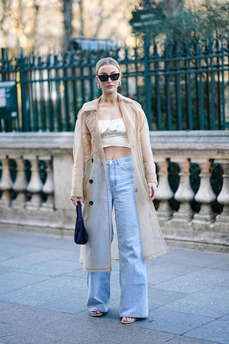 <p>Nineties style to a T, light-wash baggy jeans are grunge chic with a cropped tank and long sheer jacket.</p>