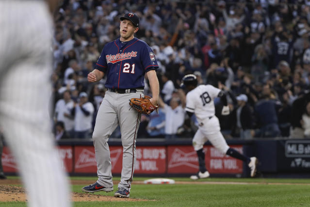 Minnesota Twins relief pitcher Tyler Duffey (21) reacts after giving up a grand slam home run to New York Yankees' Didi Gregorius during the third inning of Game 2 of an American League Division Series baseball game, Saturday, Oct. 5, 2019, in New York. (AP Photo/Frank Franklin)