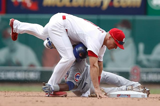 St. Louis Cardinals second baseman Mark Ellis, top, and Chicago Cubs' Junior Lake collide as Ellis tags him out at second base during the sixth inning of a baseball game Thursday, May 15, 2014, in St. Louis. (AP Photo/Sarah Conard)