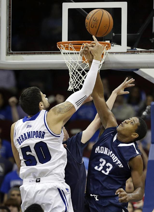 Monmouth center Zac Tillman (33) goes up to block a shot by Seton Hall forward Aaron Geramipoor (50), of England, during the first half of an NCAA college basketball game in Newark, N.J., Monday, Nov. 18, 2013. (AP Photo/Mel Evans)