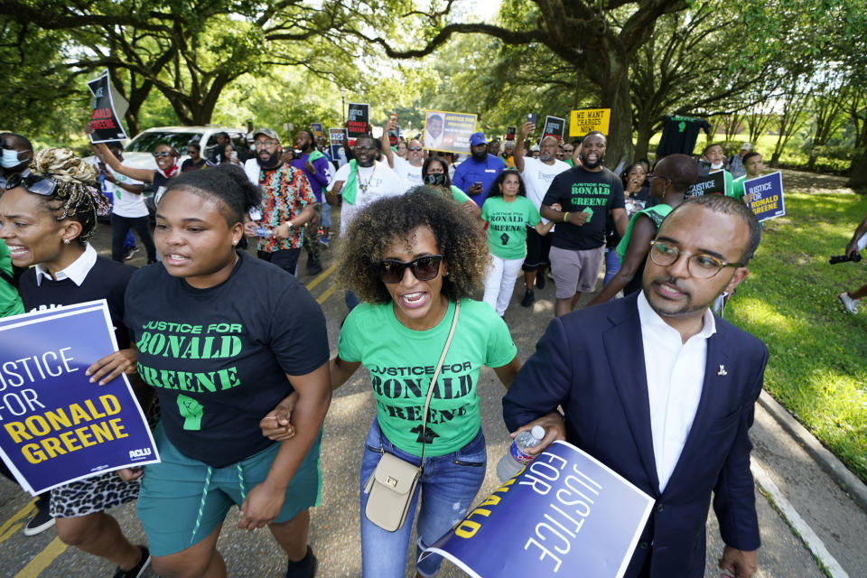 People participate in a march from the state Capitol to the governor's mansion in Baton Rouge, La., Thursday, May 27, 2021, protesting the death of Ronald Greene, who died in the custody of Louisiana State Police in 2019. At right is Ron Haley, attorney for the Greene family. (AP Photo/Gerald Herbert)