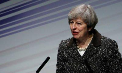 Theresa May warns internet giants over extremist material