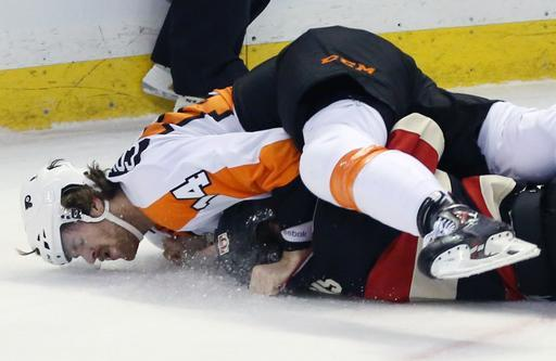 Philadelphia Flyer's Sean Couturier (14) fights with Ottawa Senator's Kyle Turris (7) during the first period of an NHL hockey game on Monday, Dec. 9, 2013. in Ottawa, Ontario. (AP Photo/The Canadian Press, Fred Chartrand)