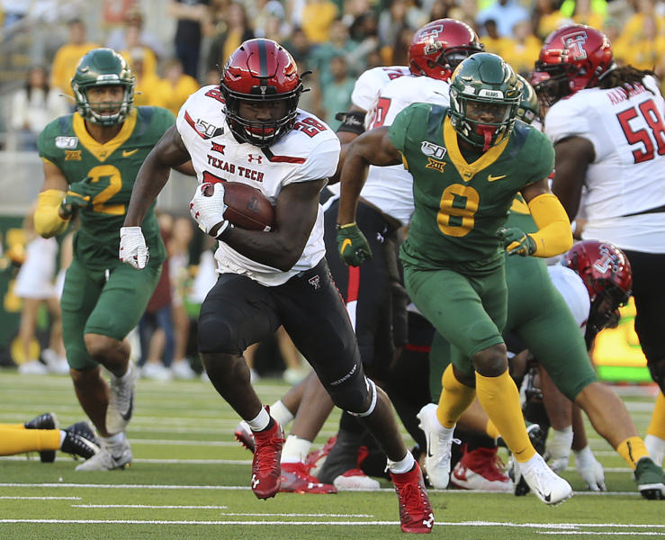 Texas Tech running back SaRodorick Thompson (28) runs past the Baylor defense for a touchdown during the second half of a NCAA college football game in Waco, Tex.,Saturday, Oct. 12, 2019.(AP Photo/Jerry Larson)