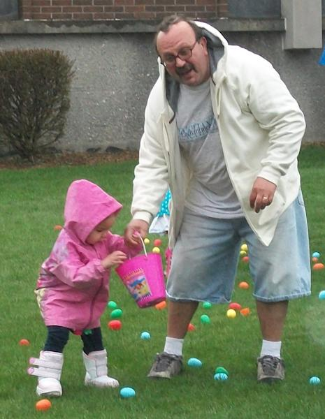 In this undated 2011 family photo Arnold Giammarco holds the hand of his daughter Blair, 2, at an Easter Egg hunt in Groton, Conn. Giammarco legally immigrated to the United States with his family in 1960 at age 4. Never having become an American citizen Giammarco, a U.S. Army veteran, was deported back to Italy in November of 2012 after serving time on criminal charges. Blair turns 5 years-old tomorrow. (AP Photo/Courtesy of Sharon Giammarco, Family Handout)